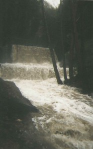 Here's a view of the first Winter Creek check dam upstream from Roberts' Camp. Note the stair-step appearance of the inundated check dam. The larger dam's footing is protected by the smaller sill dam in the foreground. In the great 1969 Flood, also an El Nino year, all the dams in the main Big Santa Anita Canyon, downstream from the confluence of the North Fork, lost their sill dams in just one evening. Sadly, ten cabins also washed away.